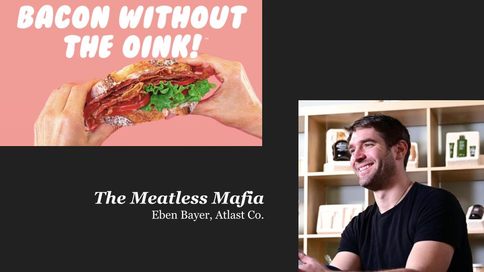 white hands holding a BLT sandwich with words ″Bacon without the oink!″ and a white man in a black shirt smiling to the left